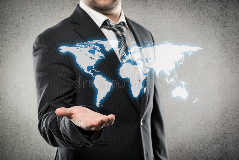 Businessman showing world map. Businessman with open palm showing world map. Concept of worldwide trade and ecommerce stock photo