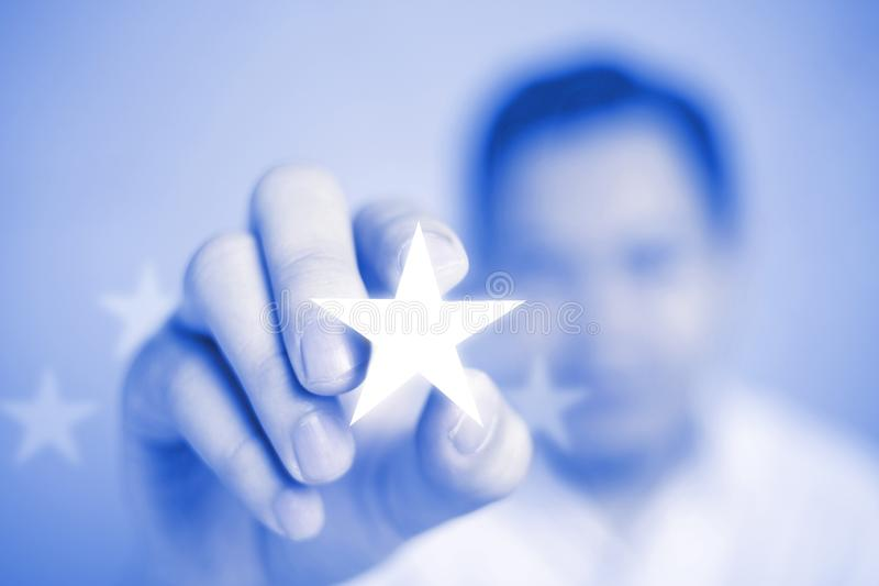 Businessman Shows Bright Star, Excellence in Service Concept. Businessman shows bright star, excellence in business service concept, high rank achievement royalty free stock photography