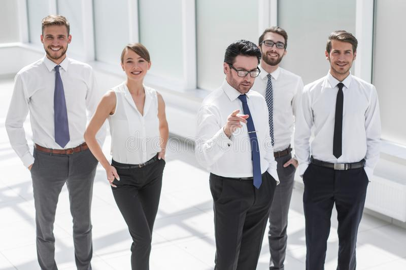 Businessman shows the business team the way to success stock photos