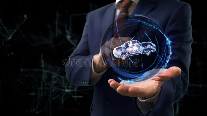 Businessman shows concept hologram 3d Pickup truck on his hand royalty free stock image