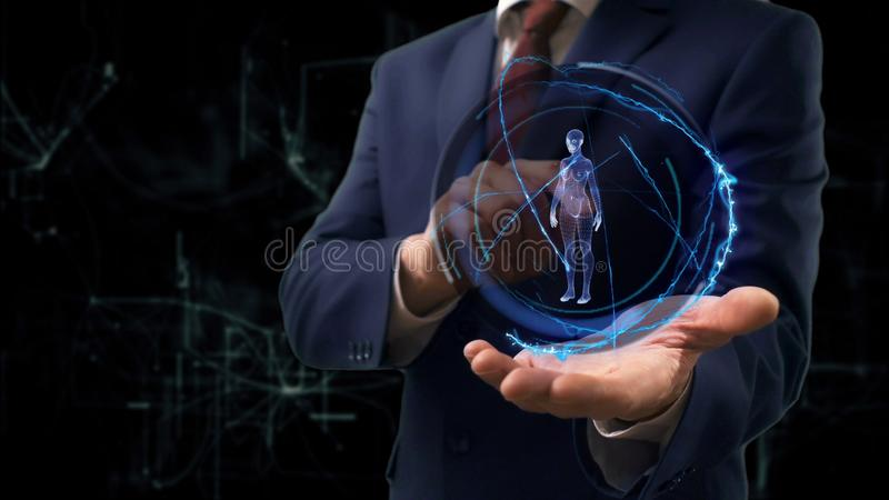 Businessman shows concept hologram 3d woman on his hand stock photos