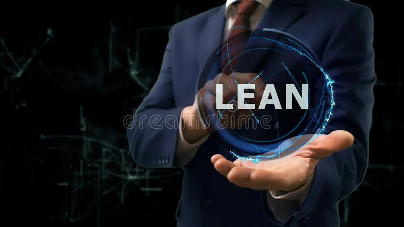 Businessman shows concept hologram Lean on his hand. Businessman shows concept hologram Lean French on his hand. Man in business suit with future technology stock images