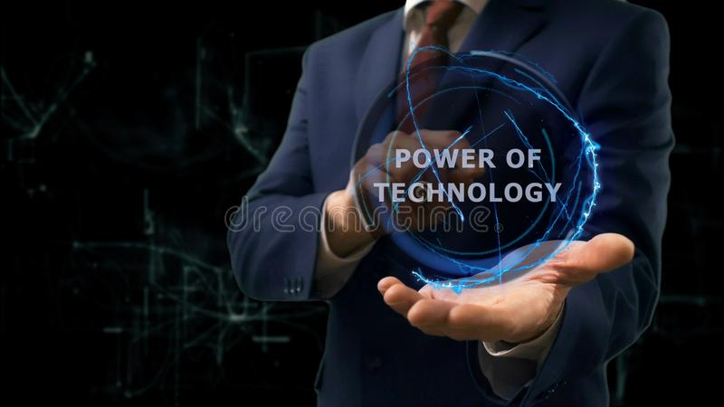 Businessman shows concept hologram Power of technology on his hand. Man in business suit with future technology screen and modern cosmic background stock photos