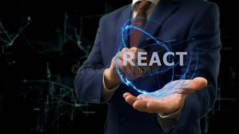 Businessman shows concept hologram React on his hand. Man in business suit with future technology screen and modern cosmic background stock photography