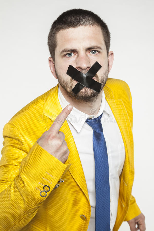 Businessman shows his sealed lips, a conspiracy of silence royalty free stock photography