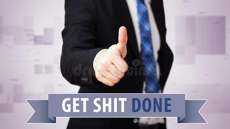 Businessman shows thumb up to `Get shit done!` stock photo