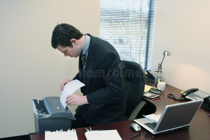 Businessman Shredding Documents stock photos