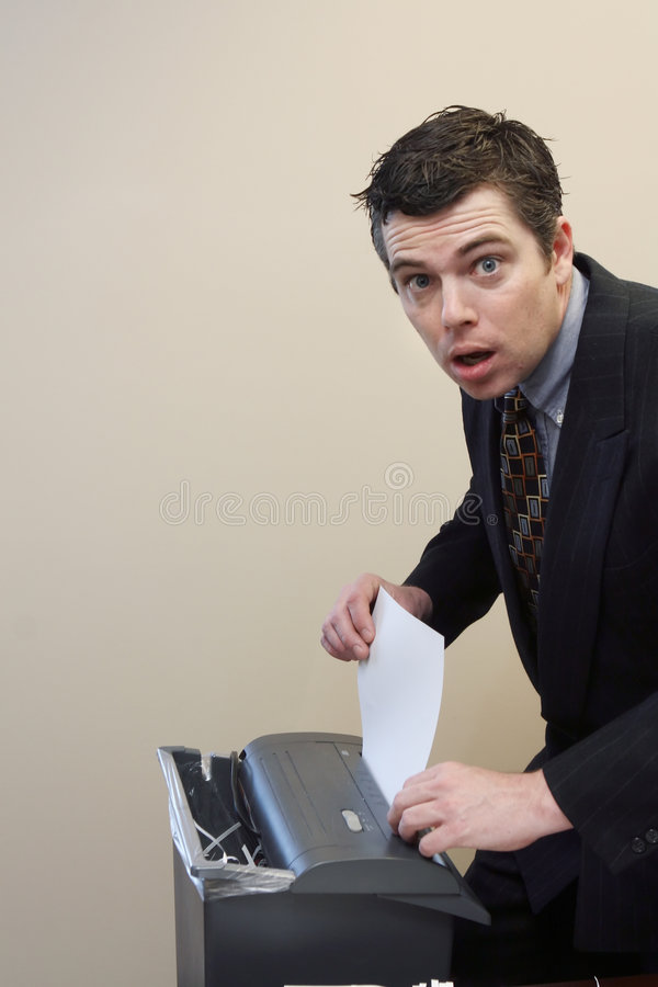 Download Businessman Shredding Documents Stock Photo - Image: 5107460