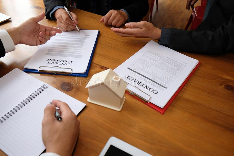 Businessman sign contract agreement with realtor. buying, selling & renting real estate property. Businessman signing contract agreement with realtor. buying stock images