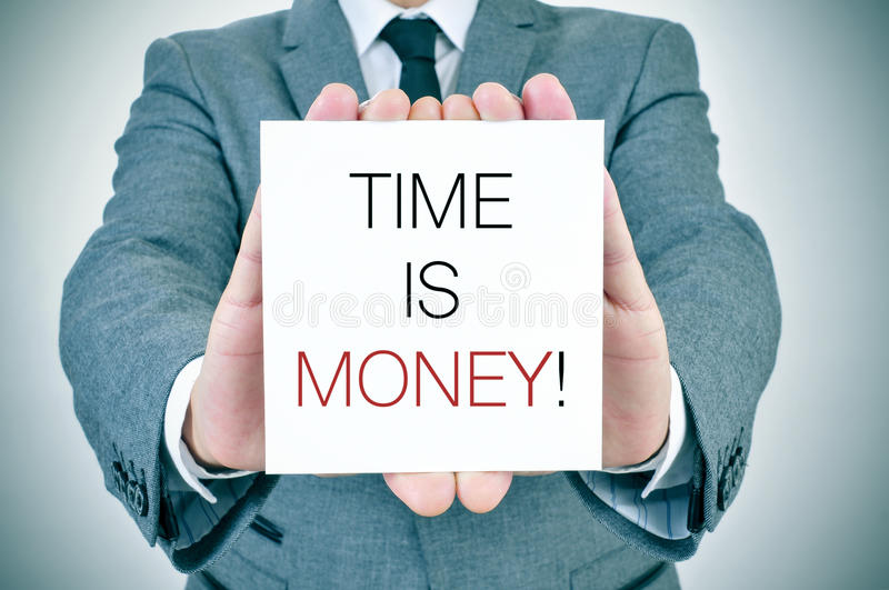 Businessman with signboard with text time is money royalty free stock photos