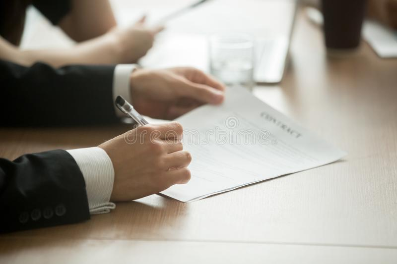 Businessman signing business contract concept, close up view stock photography