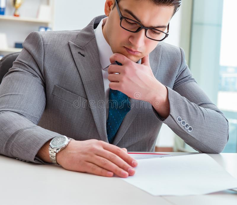 Businessman signing business documents in office royalty free stock image