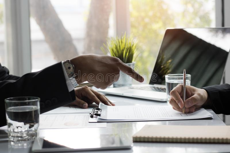 Businessman signing contract paper with partner, reach agreement stock image
