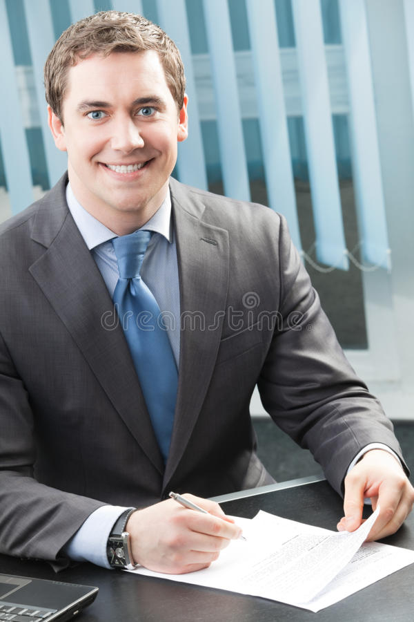 Businessman Signing Document Stock Photography