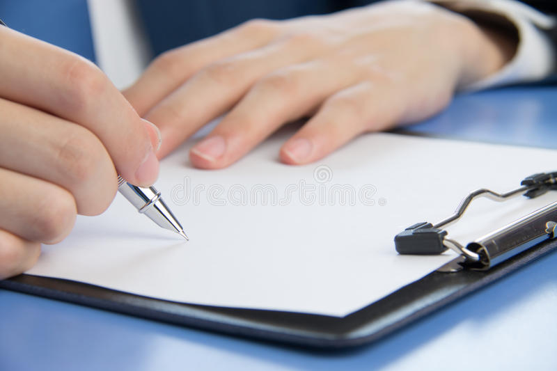 Businessman signing documents. In the office royalty free stock photo