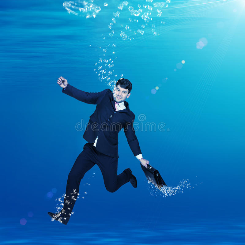 Businessman sinking in water stock images