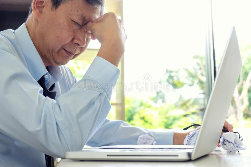 businessman sit at the table fill sad and headache stock photo