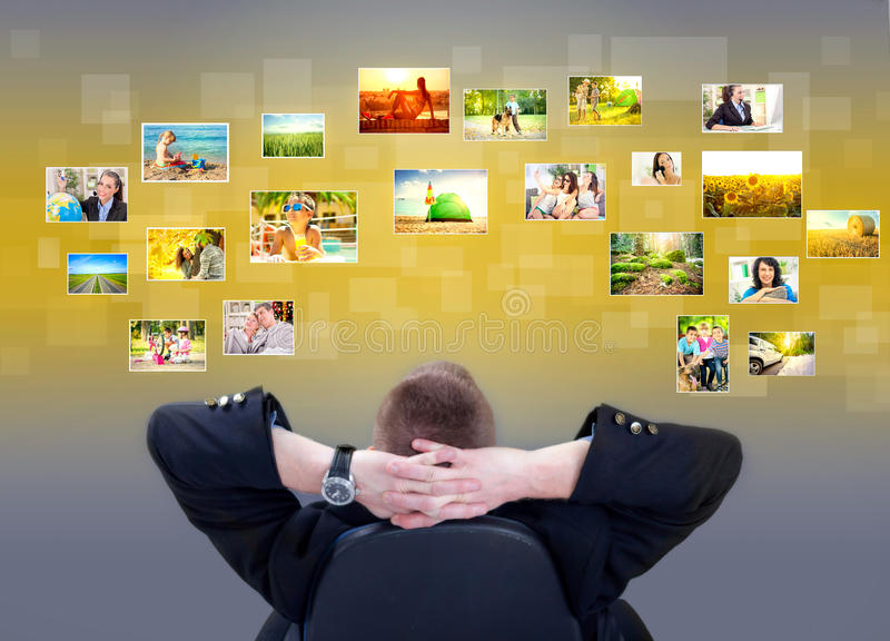 Businessman siting and looking at photo gallery images. Businessman sitting and looking at pictures with memories stock images