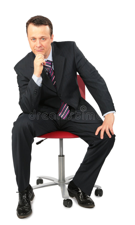 Businessman sits in office chair royalty free stock image