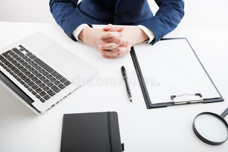 Businessman sitting alone and folded his hands together. stock image