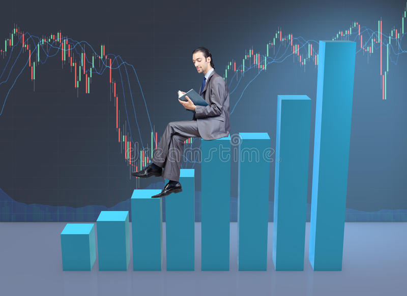 The businessman sitting on bar charts in business concept. Businessman sitting on bar charts in business concept royalty free stock images