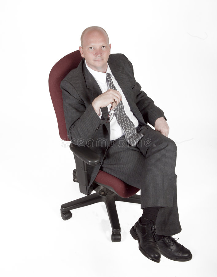Download Businessman Sitting In A Chair Stock Image - Image: 1013699