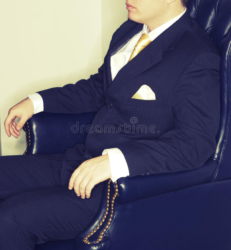 Businessman sitting in chair stock photography