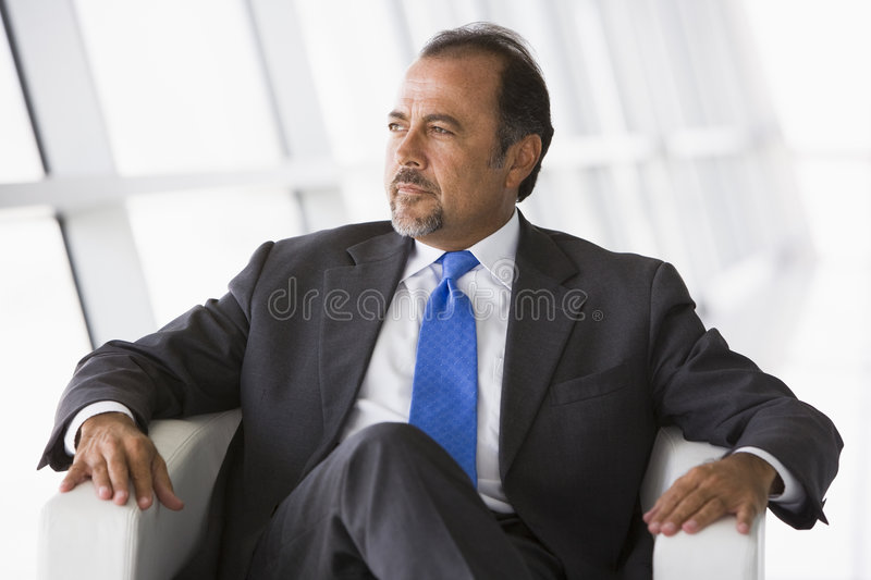 Businessman Sitting In Chair In Lobby Royalty Free Stock Images