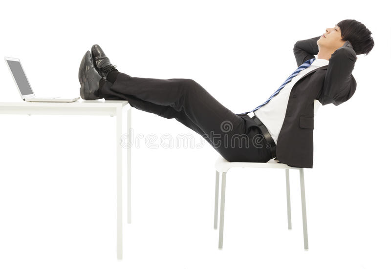 Businessman sitting on a chair to take a rest stock photo