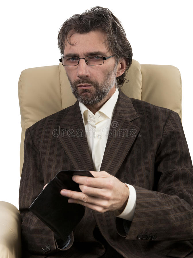 Businessman sitting in chair with wallet. Businessman in suit sitting in chair with wallet isolated white stock photography
