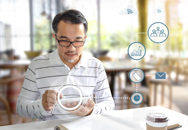 Businessman sitting in the coffee shop and writing on a digital tablet. Many people are able to study or work in various places. Because of communication with royalty free stock image