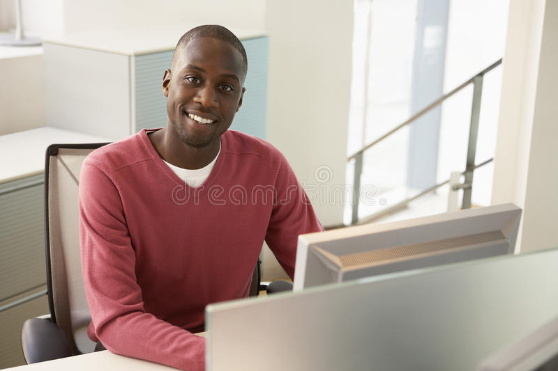 Businessman Sitting At Computer Desk royalty free stock images