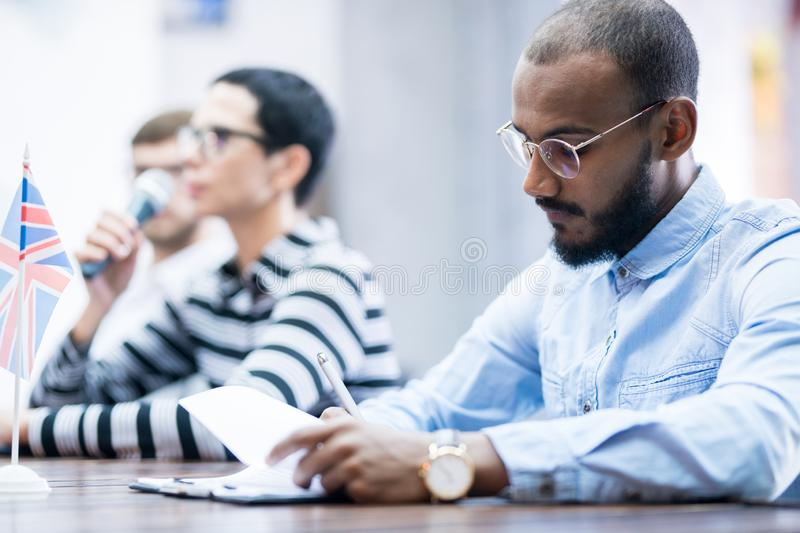Businessman sitting at conference stock photos