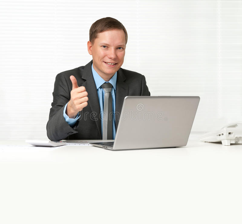 Download Businessman Sitting At Desk With Laptop Stock Photo - Image of good, people: 26607288