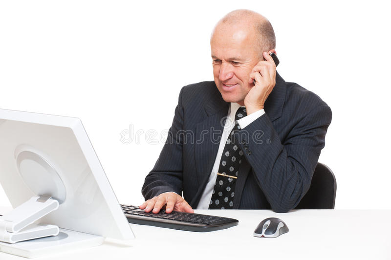 Download Businessman Sitting At Desk In Office Stock Image - Image: 23501905
