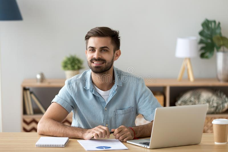 Businessman sitting at the desk in office stock photo