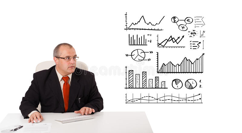 Download Businessman Sitting At Desk With Statistics Royalty Free Stock Images - Image: 27884489