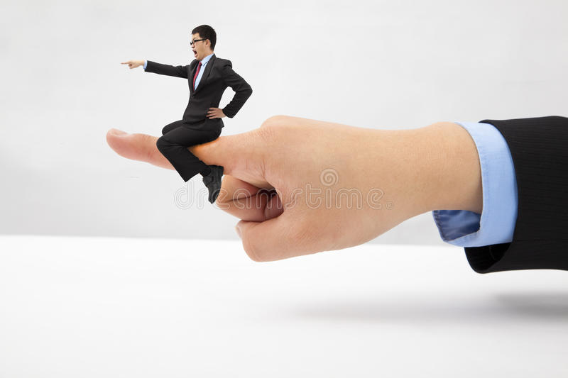 Businessman sitting on the finger shouting royalty free stock photography