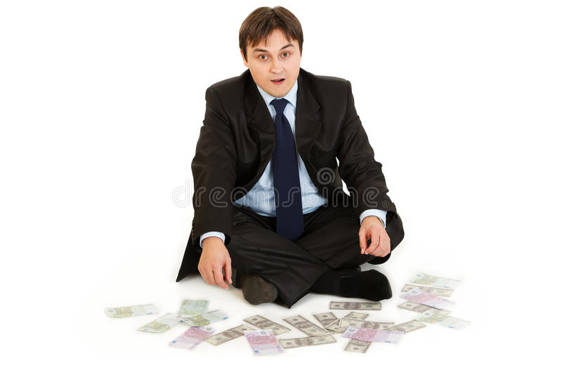 Download Businessman Sitting On Floor Surrounded By Money Royalty Free Stock Photos - Image: 18633728
