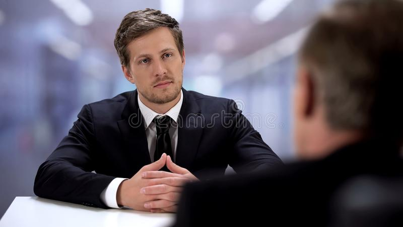 Businessman sitting front colleague, successful partners meeting, cooperation stock photos