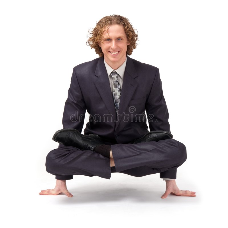 Businessman sitting in full lotus position. Business yoga. Businessman sitting in full lotus position stock images