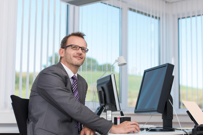 Download Businessman Sitting At His Desk Thinking Stock Photo - Image: 34293412