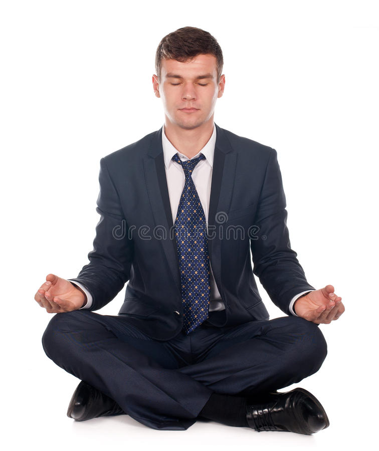Businessman sitting in lotus position. Isolated on white background stock photos