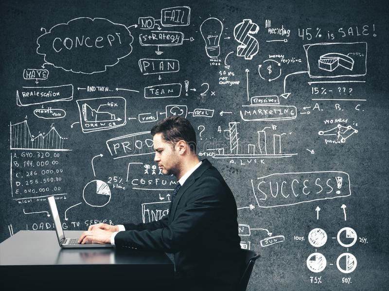 Businessman sitting in office. And drawing business concept gray on wall stock photos