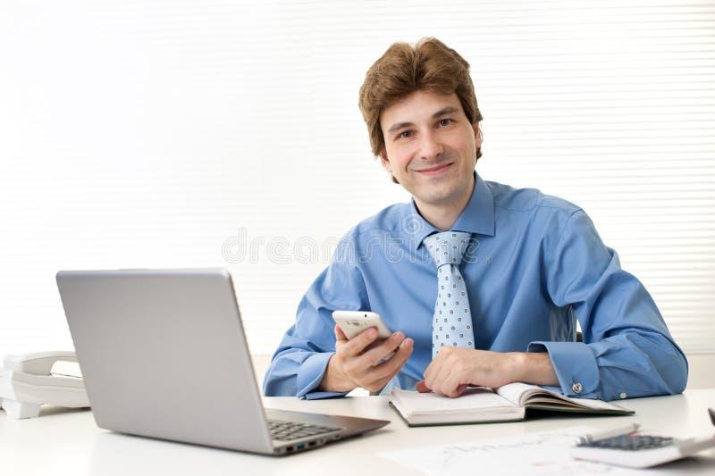 Download Businessman Sitting At Office Desk Stock Image - Image: 27655911