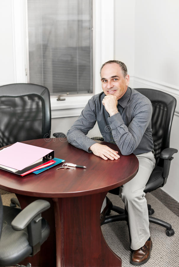 Businessman sitting in office meeting room stock photos