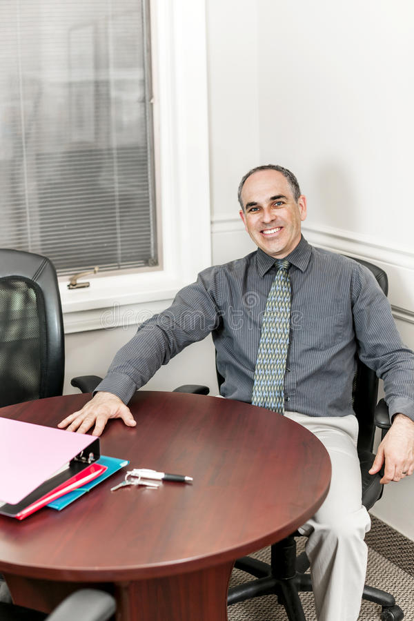 Businessman sitting in office meeting room stock photo