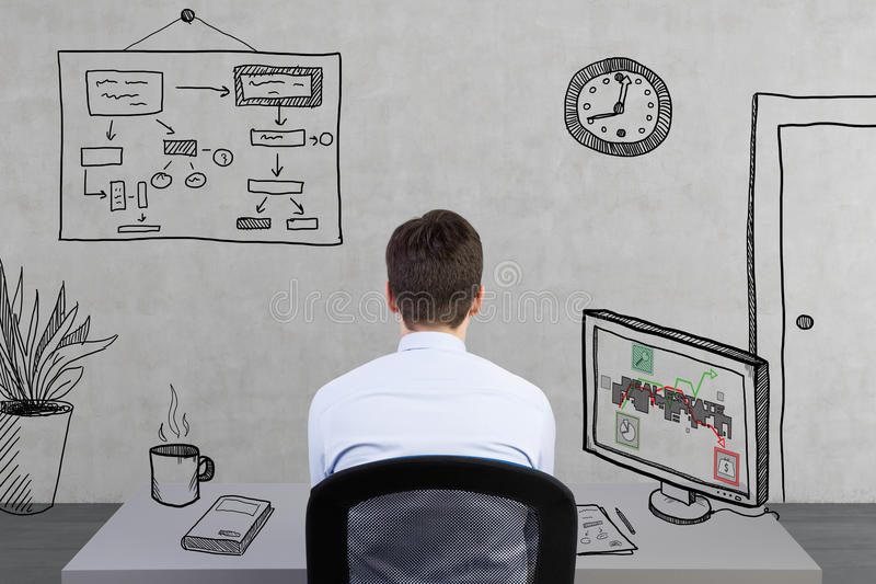 Businessman sitting in office. With real estate symbol on screen stock photos