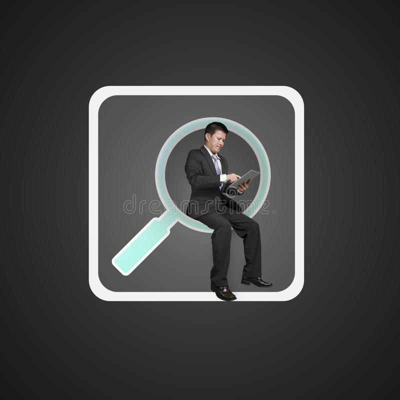 Businessman sitting on searching app icon using smart pad royalty free stock images