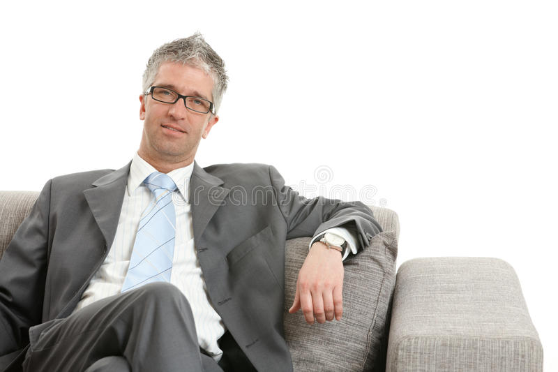 Download Businessman Sitting On Sofa Stock Photo - Image of hair, dressed: 9524112